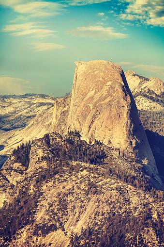 Old film retro toned Half Dome rock formation, Yosemite National Park, USA.