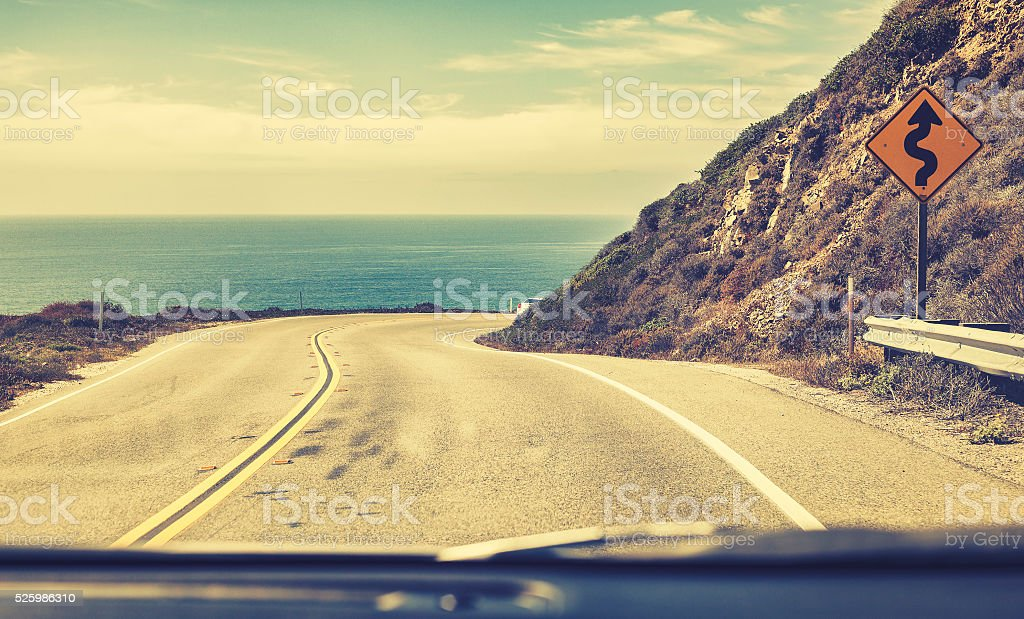 Old film stylized road seen through windshield, stock photo