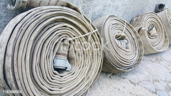 old fire hoses close-up, including aluminum piping and valves.