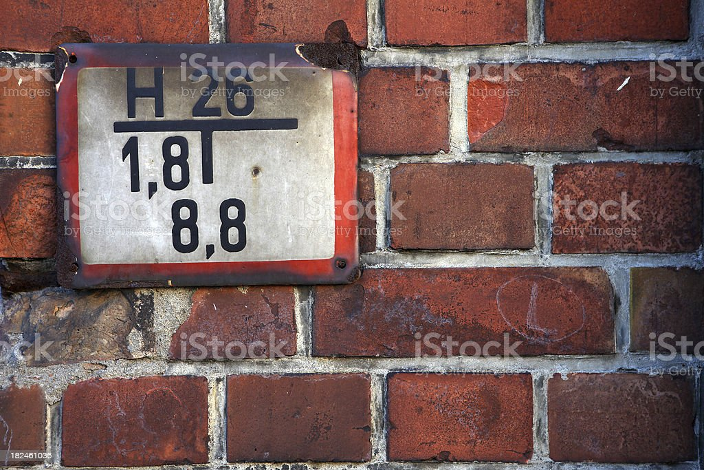 Old fire plate on the wall of brick royalty-free stock photo
