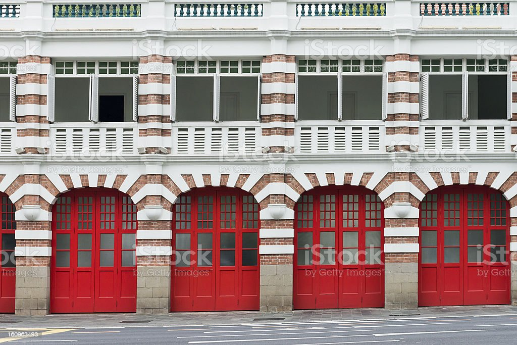 Old fire station with red gates stock photo