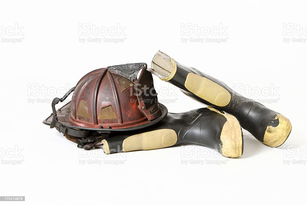 Old Fireman's Helmet & Boots on White Background stock photo