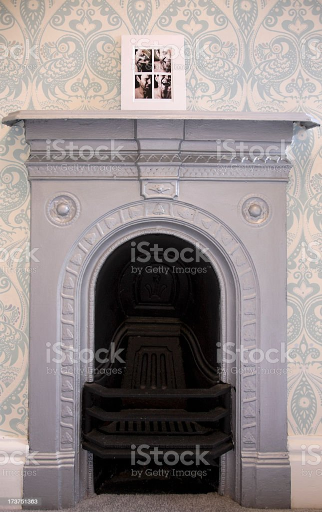 Old Fireplace with Photo on Mantelpiece. royalty-free stock photo