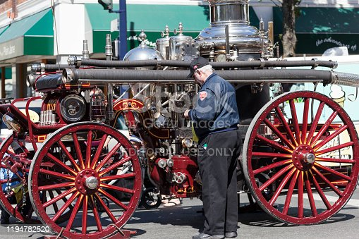 Victoria B.C. Canada Jun 23, 2019: And old fire-engine on display at the  Victoria Day Festival. Music, food, and vendors are allover. While many dresses for fun.