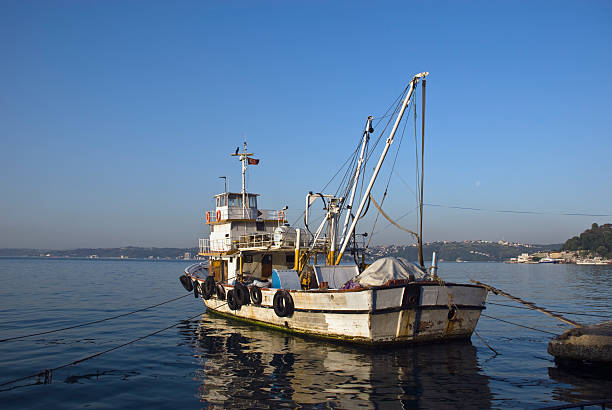 Old fisher boat of Bosphorus stock photo