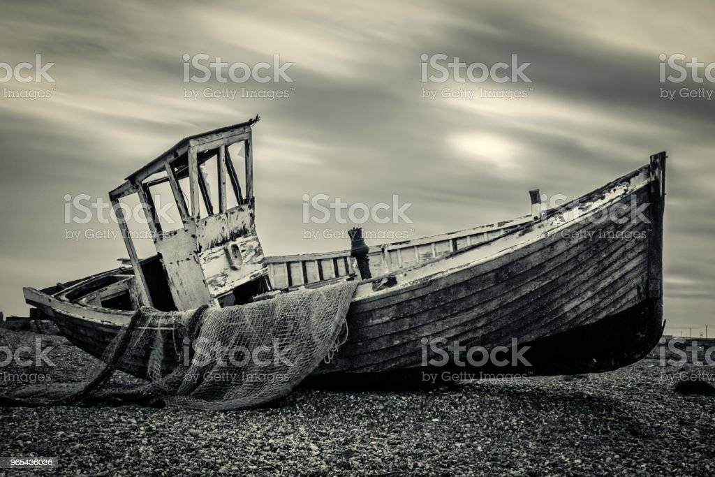 Old fisher boat on a shingle beach near Dungeness royalty-free stock photo