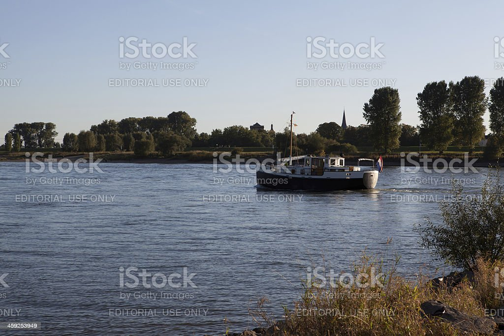 old fisher boat passing on the Rhine river stock photo
