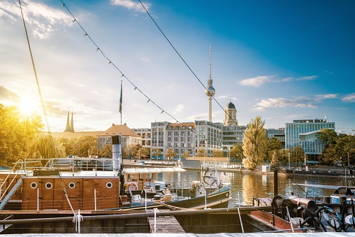 old fishermans boats in  berlin with view on tv-tower