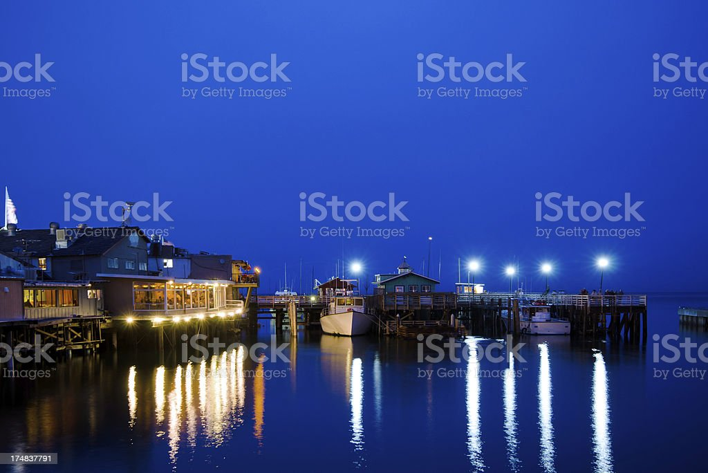 Old Fisherman's Wharf in Monterey, CA at night royalty-free stock photo