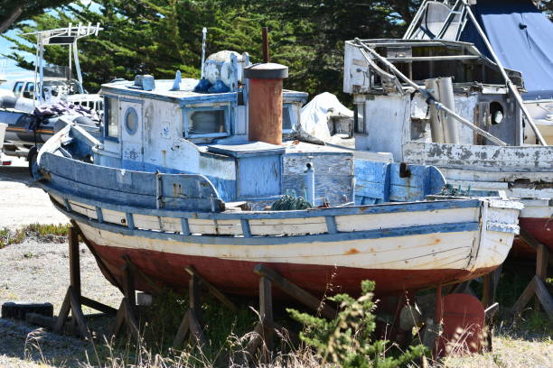 old fishing boat in dry dock - steven harrie stock photos and pictures