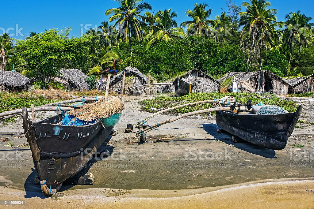 Old fishing boat on the beach in tropical country stock photo