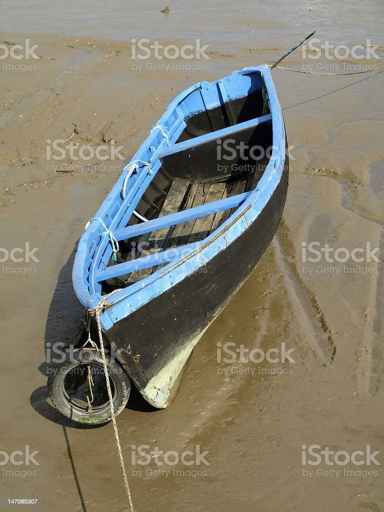 Old fishing boat stuck in the mud royalty-free stock photo