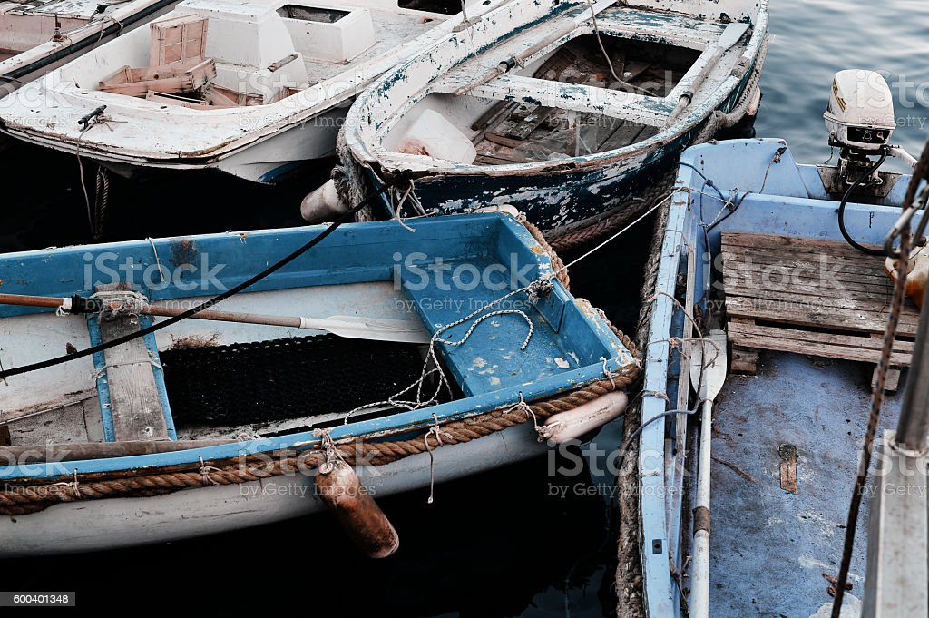 Old fishing boats in the port stock photo