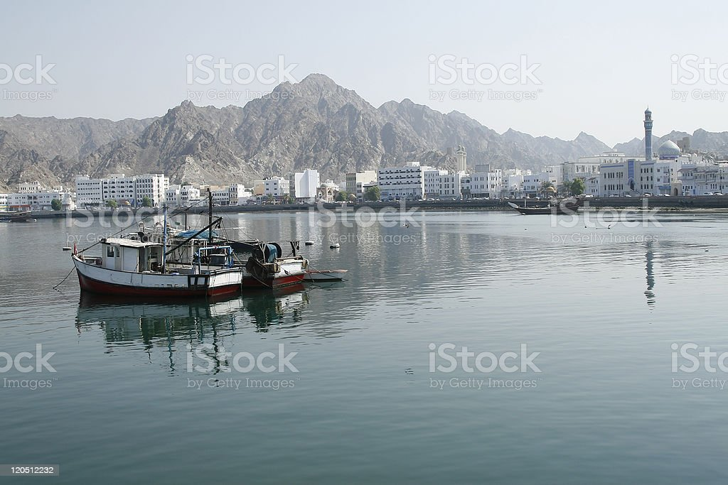 Old fishing boats on the Bay of Muscat, Oman royalty-free stock photo