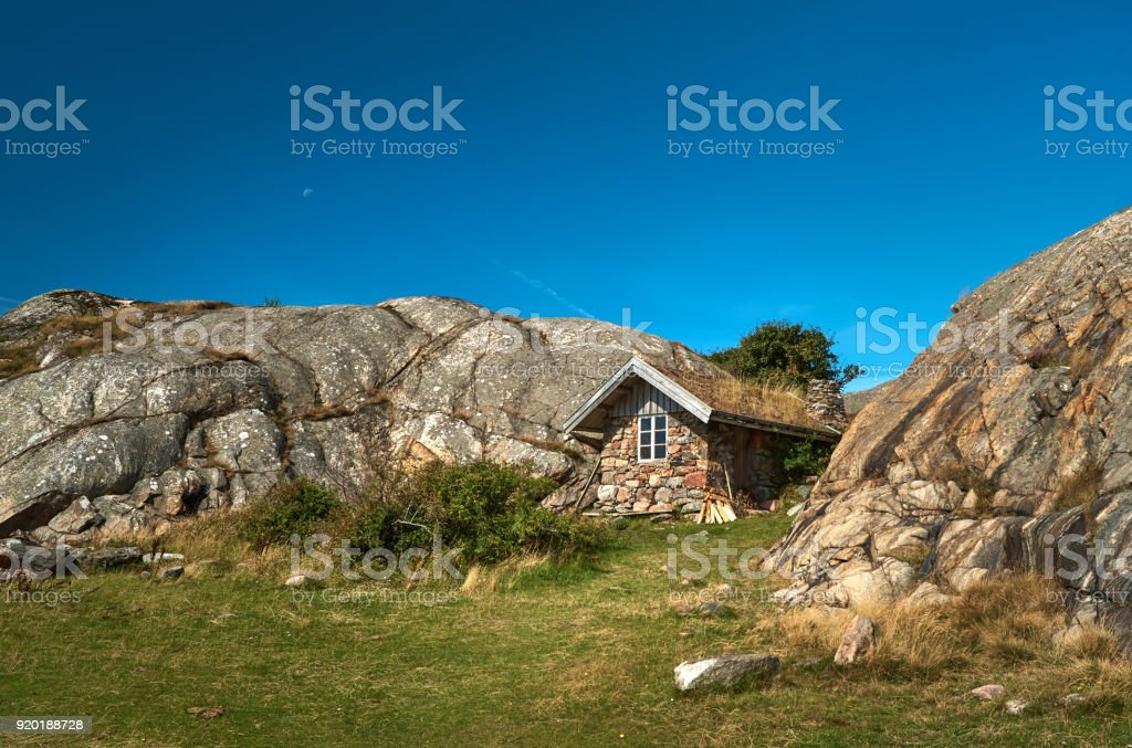 Old fishing house in Swedish archipelago in summer under clear blue sky. stock photo