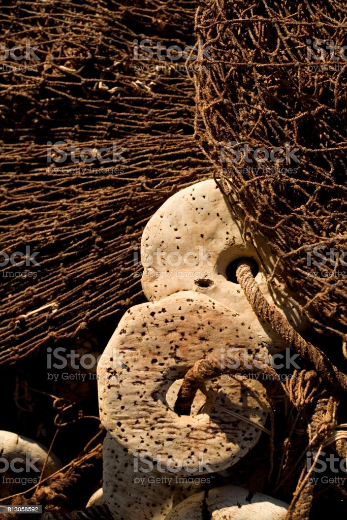 Old fishing nets and floats stock photo