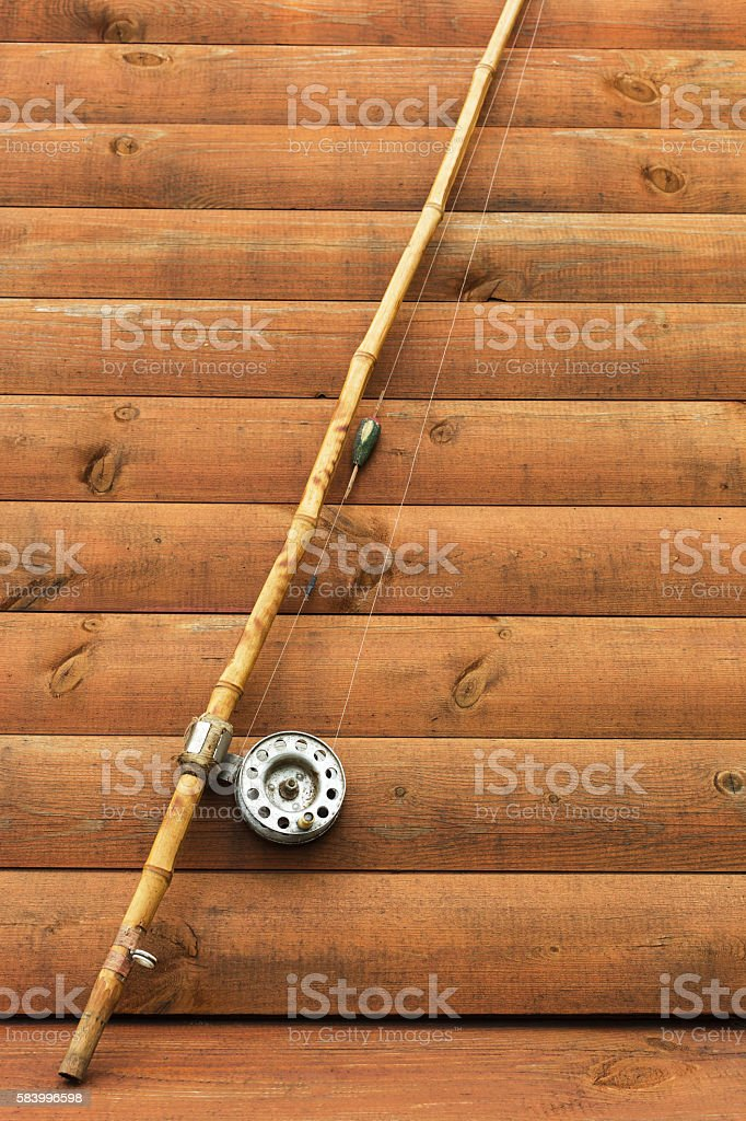 Old Fishing Rod On Wooden Background Stock Photo Download Image