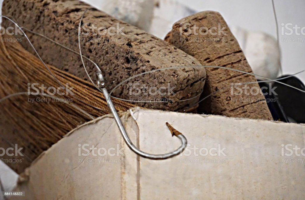 Old fishing rusty hook and fishing tackles stock photo