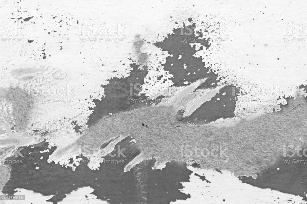 Oude schilferige verf Peeling uit een Grungy gebarsten muur. Scheuren, Peeling van oude verf en gips op achtergrond van oude Cement muur. Witte en grijze vlekken van verf. Een oude stenen muur van de Cement als Vintage gekraakt - Royalty-free Abstract Stockfoto