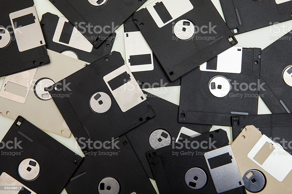 Old floppy disk to the computer stock photo