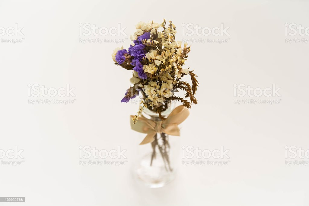 Old flower in glass tube stock photo