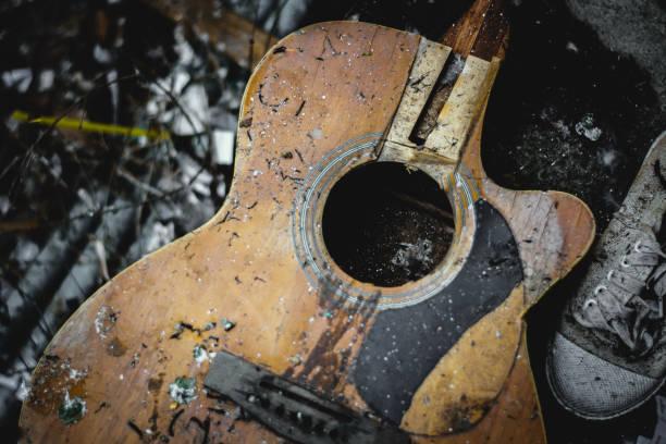 old folk guitar - broken guitar stock photos and pictures