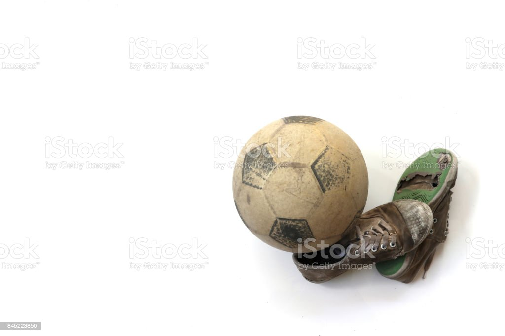 old football and old shoes isolated on white background stock photo