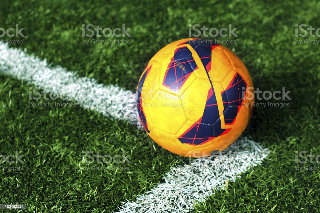 old football on soccer field royalty-free stock photo