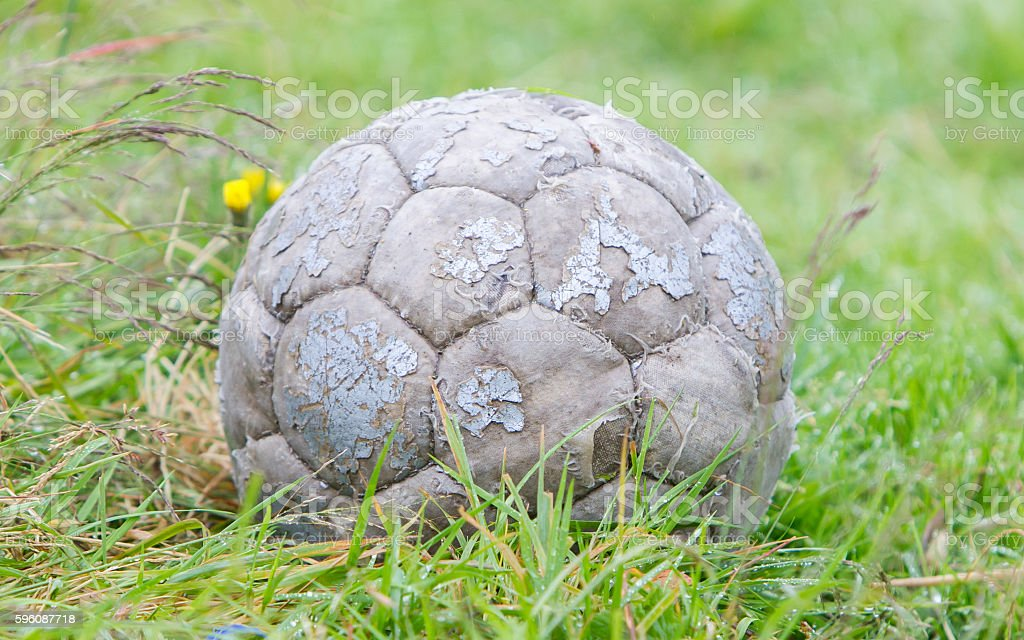 Old football used by a dog royalty-free stock photo
