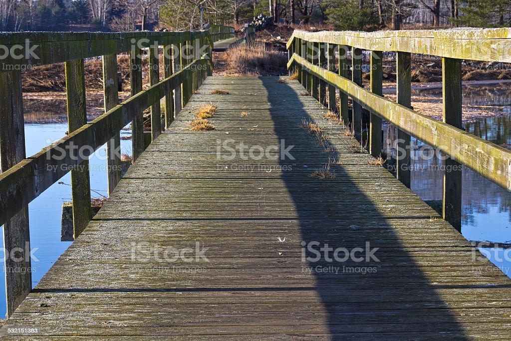 Old footbridge over water stock photo