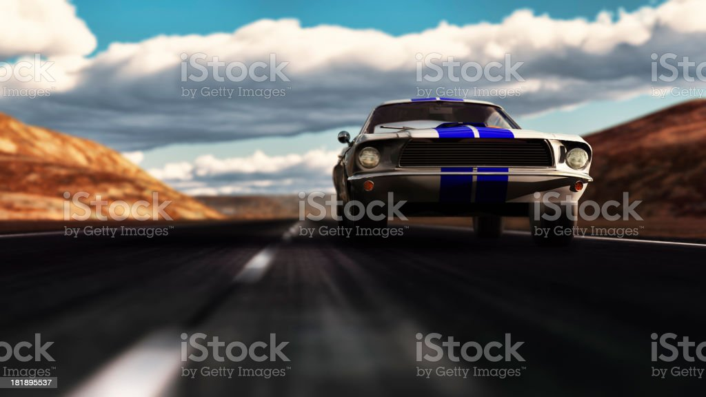 Old Ford Mustang 1966 speeding on empty dessert road stock photo