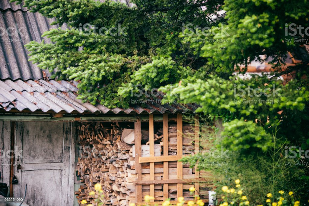 Old forest hunter's house with harvested wood. royalty-free stock photo