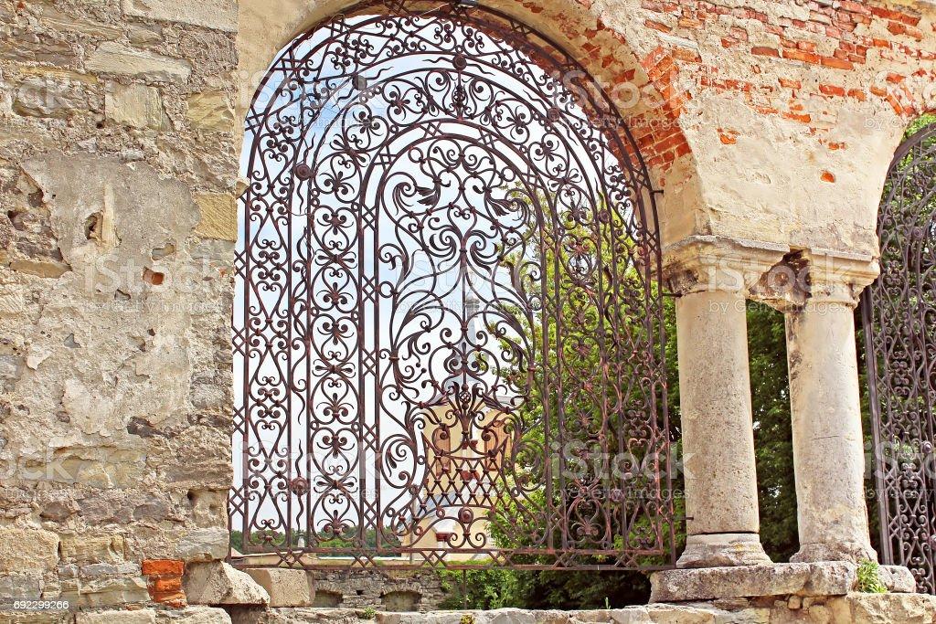 Old forged gate to armenian church, Kamianets-Podilskyi, Ukraine stock photo