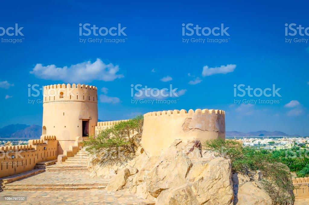 Old fort, an oasis and blue sky. - Zbiór zdjęć royalty-free (Architektura)