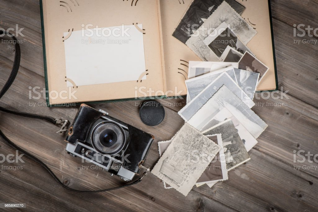 Old foto album with photos and cam - Royalty-free Above Stock Photo