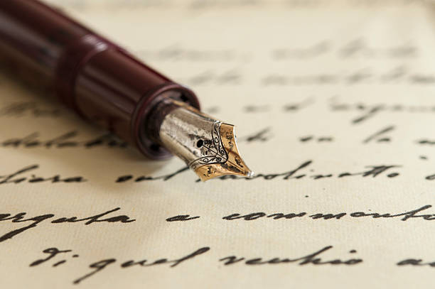 old fountain pen on manuscript - literature stock pictures, royalty-free photos & images