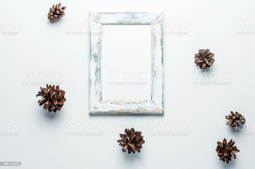 Old frame and cones on white background. Christmas deciration royalty-free stock photo