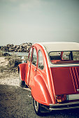 istock Old French classic Deux Chevaux or Ugly Duckling or car parked in the dunes near the beach in Brittany, France during a summer vacation 1068661892