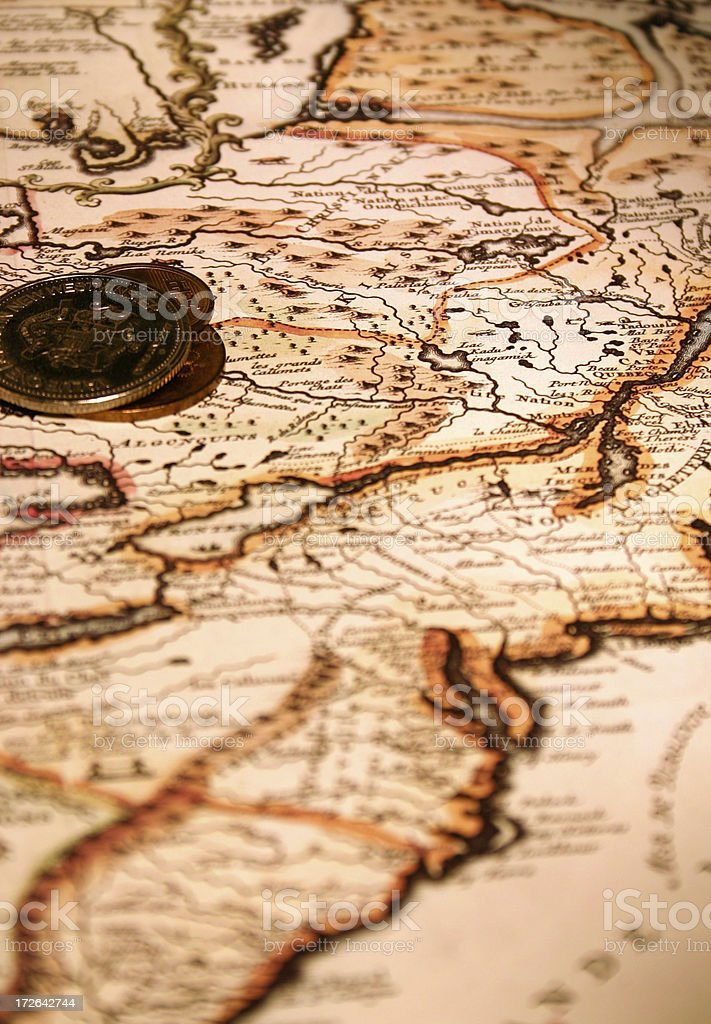 Old French Map With Coins royalty-free stock photo