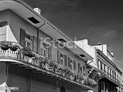 New Orleans, LA USA - May 9, 2018  -  Old French Quarter Building with Balcony with Flowers #8 B&W