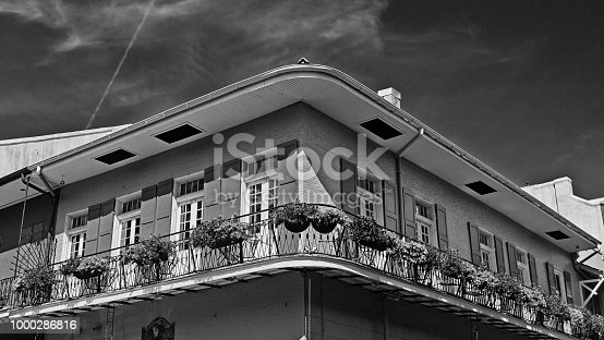 New Orleans, LA USA - May 9, 2018  -  Old French Quarter Building with Balcony with Flowers #7