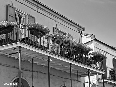 New Orleans, LA USA - May 9, 2018  -  Old French Quarter Buildings with Balcony and Flowers #5 B&W