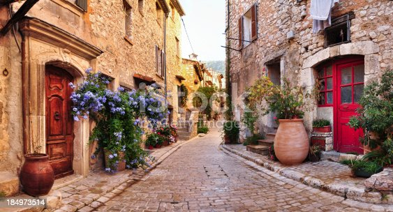 istock Old French village houses and cobblestone street 184973514