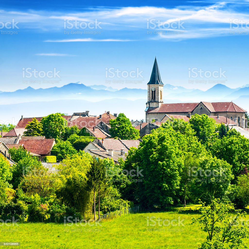 Old French village in countryside with Alps mountains in summer stock photo