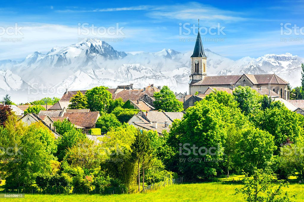 Old French village in countryside with Mont Blanc Alps mountains stock photo