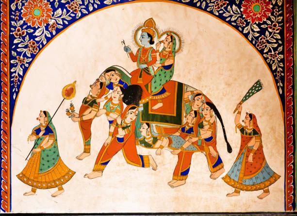 old fresco with krishna and radha riding the weird elephant - induismo foto e immagini stock