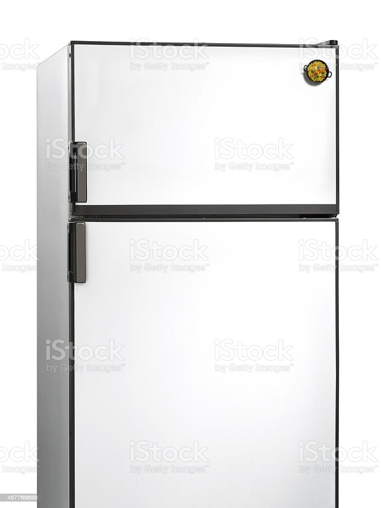Old fridge with paella plastic magnet stock photo