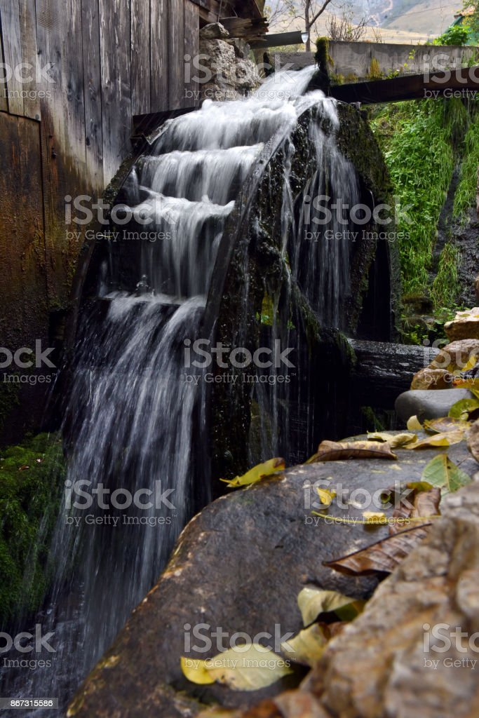 Old functional working mill wheel stock photo