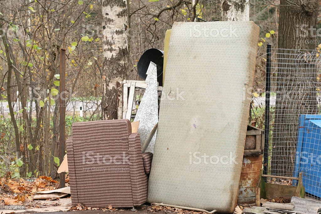 Old furniture abandoned at the roadside royalty-free stock photo