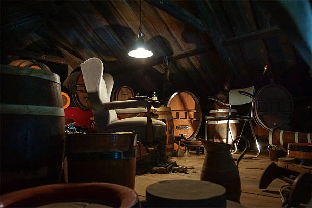 old furniture on an attic, dimly lit - dimly stock pictures, royalty-free photos & images